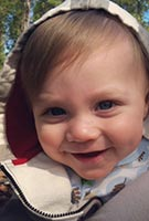 Csid sucraid infant male patient in mothers arms